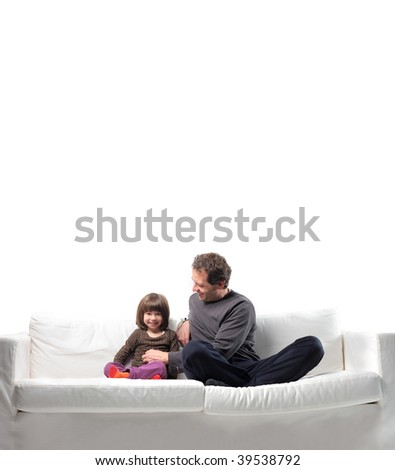 playful father tickling his little daughter - stock photo