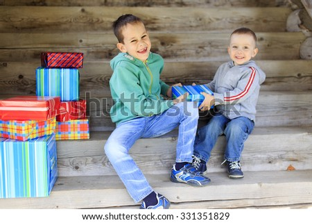 playful fight for gift. laughing funny children fighting over a gift - stock photo