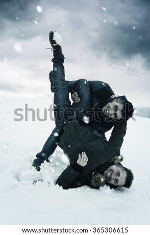 playful friends playing with snow outside - stock photo