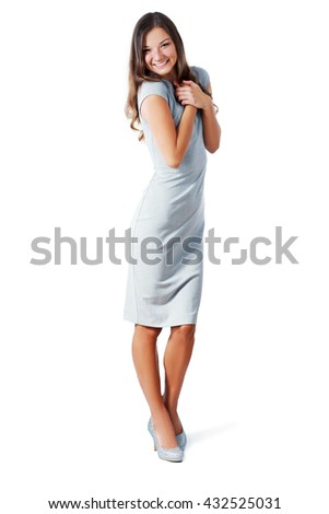 Playful funny woman excited standing in high heels and light grey dress. Beautiful happy mixed race Asian Caucasian model isolated on white background in full body. - stock photo