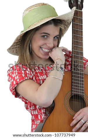 Playful girl holding guitar - stock photo