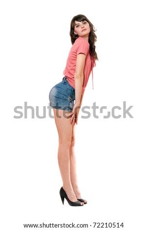 Playful girl in jeans mini skirt. Isolated on white - stock photo