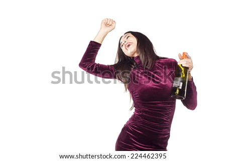 playful, happy young woman with a bottle in her hand - stock photo