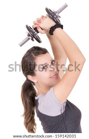 Playful hispanic woman exercising, lifting weights - stock photo