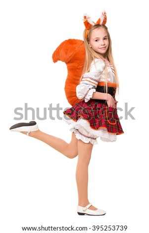 Playful little blond girl wearing like a squirrel. Isolated on white