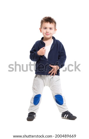Playful little boy posing in sport clothes. Isolated on white - stock photo