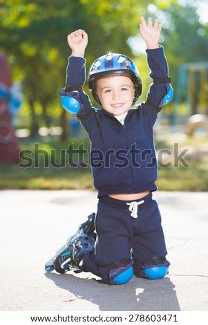 Playful little boy posing on the knee pads