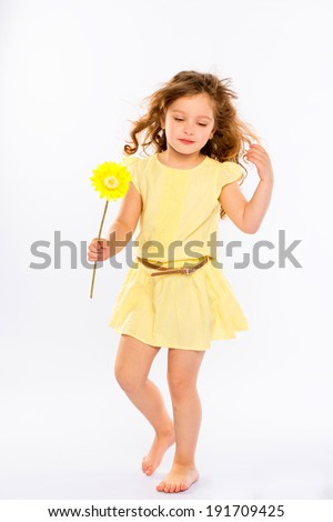 playful little girl in yellow dress - stock photo