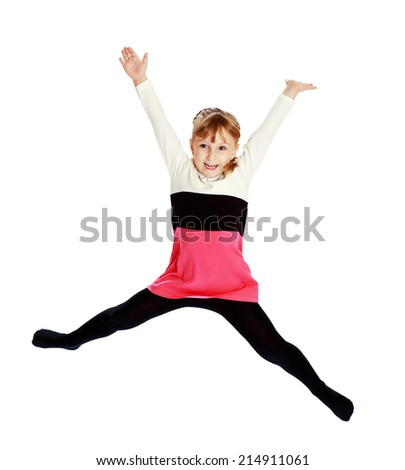playful little girl jumping high on white background.