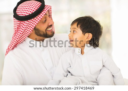 playful middle eastern father and son - stock photo