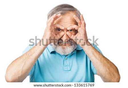 Playful old man showing eyeglasses - stock photo