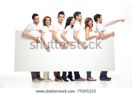 playful smiling people leading an advertising banner - stock photo
