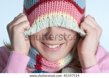 Playful winter beanie hat girl - stock photo