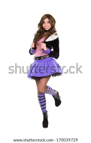Playful young brunette dressed in fashionable clothes. Isolated on white - stock photo