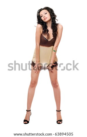 Playful young brunette in a dress. Isolated
