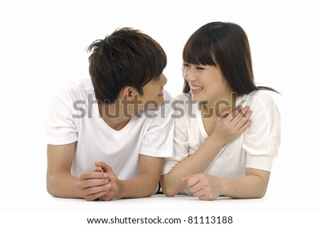 Playful young couple on white - stock photo