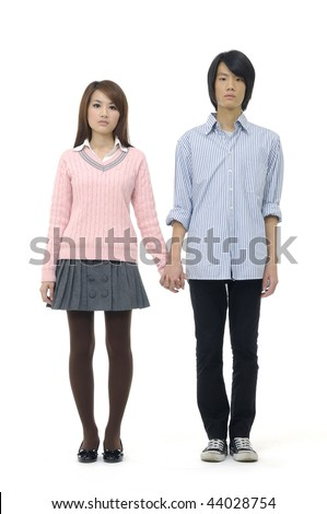 Playful young couple standing on white