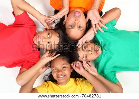 Playful young mates making funny faces - stock photo