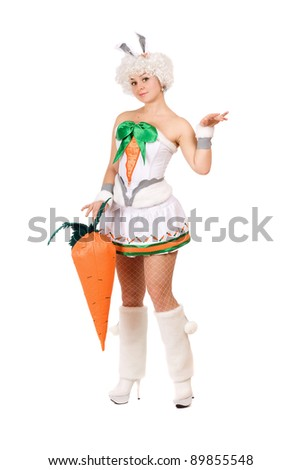 Playful young woman dressed in a suit rabbit - stock photo