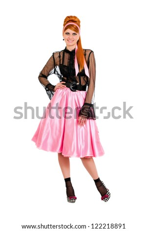 Playful young woman in a pink skirt. Isolated