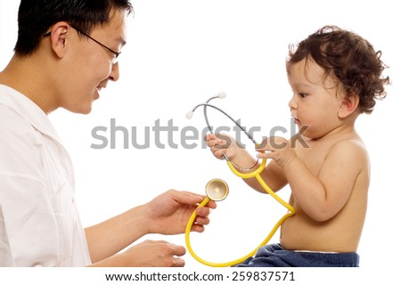 Playfull baby at the doctor,isolated on a white background. - stock photo