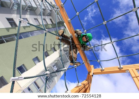 Playground and tall buildings - stock photo