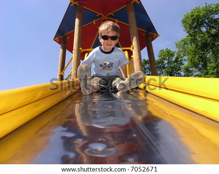 PLAYGROUND BOY - stock photo