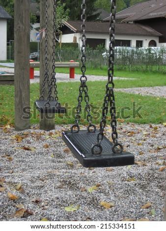 Playground swing set. Selective focus. - stock photo