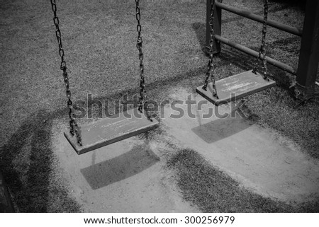 Playground with lawn at village, Black and white tone - stock photo