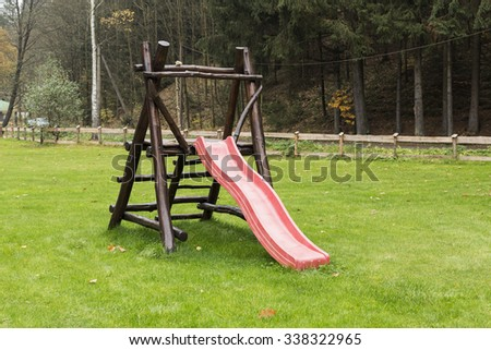 playground with slides and climbing frame in park