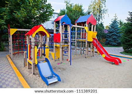 Playground with slides in the sandbox - stock photo