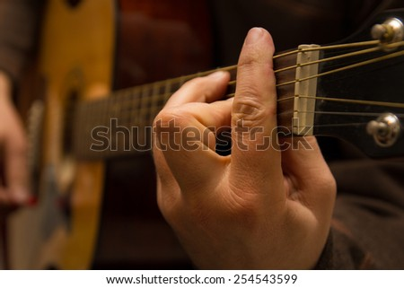 Playing a chord on guitar - stock photo