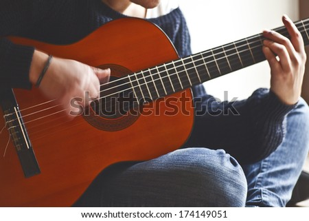 playing a classic guitar