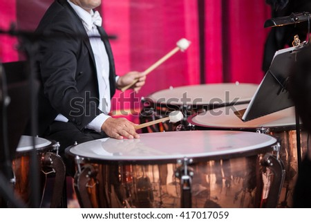 Playing a drum. Sound orchestra close up. Drum close up. Musician playing a drum. Musical concert. - stock photo