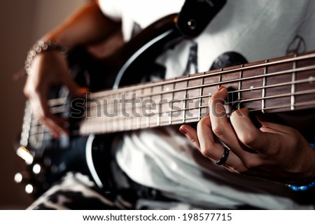 Playing a rock guitar - stock photo