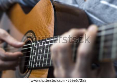 Playing and strumming guitar