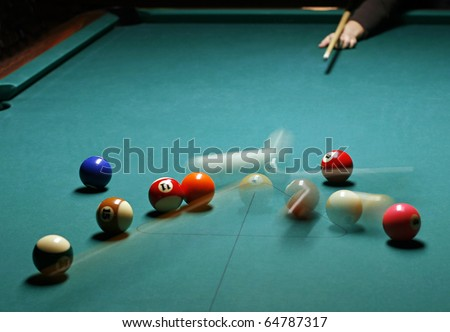 Playing at billiards - stock photo
