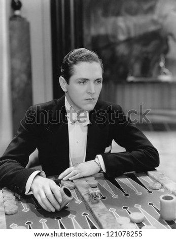 Playing backgammon - stock photo