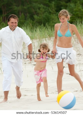 Playing ball at the beach - stock photo