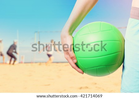 playing beach volleyball - stock photo