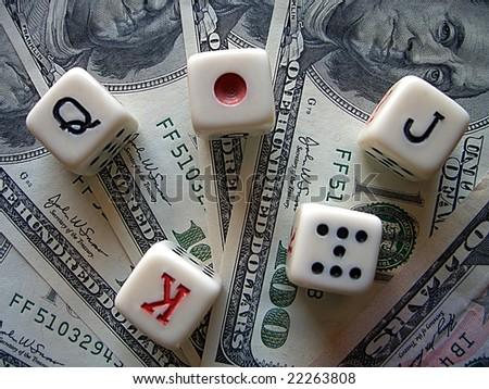 Playing bones and dollars. - stock photo
