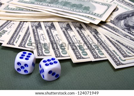 Playing bones and money on green cloth - stock photo