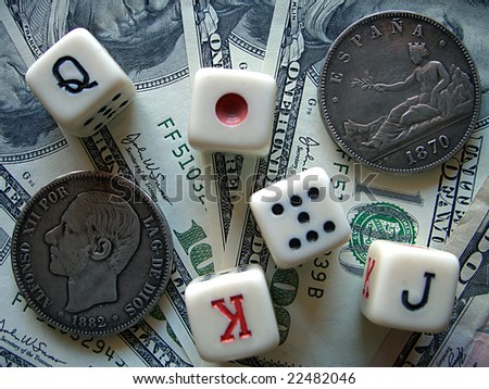 Playing bones, dollars and ancient coins - stock photo