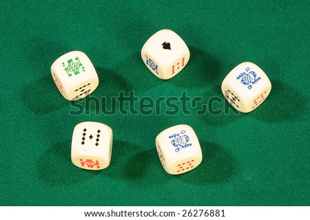 playing bones on green felt - stock photo