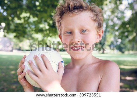 Playing boy with ball - stock photo