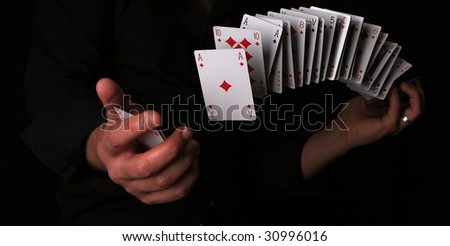 playing card trick - stock photo