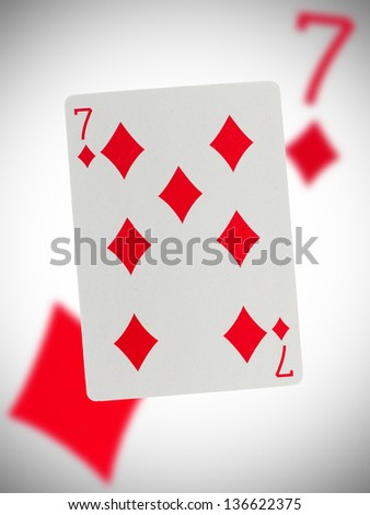 Playing card with a blurry background, seven