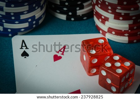 Playing Cards and Dice used with Gambling Chips - stock photo