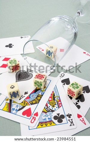 Playing cards and dices with champagne glass - stock photo