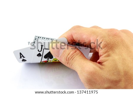 playing cards (Blackjack) in hand isolated on white background - stock photo